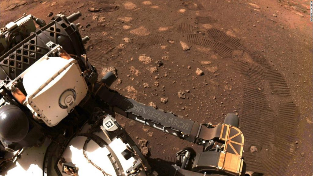 The rover takes its first command on Mars, and sends the picture again