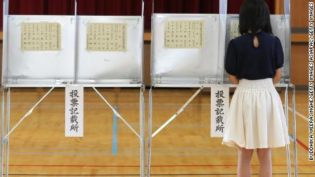An 18-year-old woman casts her vote in the upper house elections for Parliament at a polling station on July 10, 2016 in Himeji, Japan.