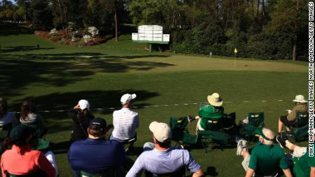 Patrons look on at the sixth green during a practice round prior to this year's Masters.