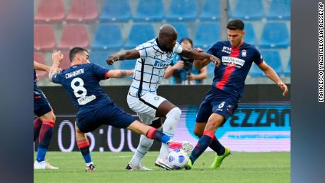 Crotone's Luca Cigarini, left, Inter Milan's Romelu Lukaku, center, and Crotone's Lisandro Magallan compete for the ball. Lukaku has scored 21 goals in Serie A this season.