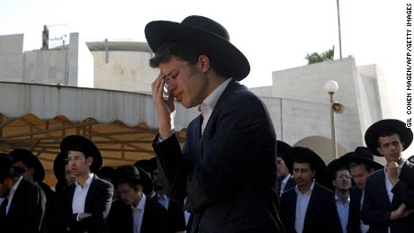 As families bury their dead, accusations against the deadly crush begin at a religious ceremony in Israel