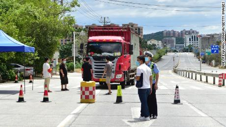 A truck stops at a checkpoint on a road in Xianyou county on September 12. Buses and trains leaving the county have been suspended.